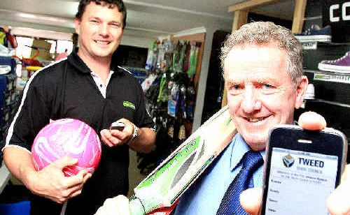 Murwillumbah Football Club president Jason Dittmar and Tweed Council's Greg Willetts.