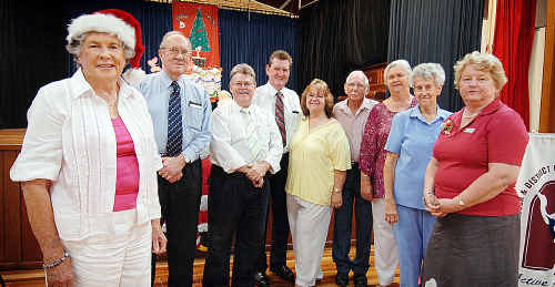 Barbara Paterson (left) retires as project director for Maryborough and District Committee on the Ageing. Among those to congratulate her this week are MADCOTA past president Gilbert Alison, Maryborough MP Chris Foley, Fraser Coast mayor Mick Kruger, vice-president Lex Tudman, president Brian Hodges, secretary Ann McLaney, treasurer Donna Suter and councillor Linda Harris.