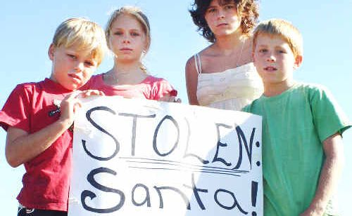 The Powell kids (from left), Phillip, 8, Maddy, 12, Caroline, 16, and Lyall, 10, had their homemade Santa stolen from their Clunes home.