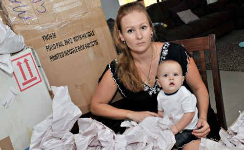 Tina Mason, with son Kodi, is livid at the shoddy treatment she received from Tewantin Furniture Removals.