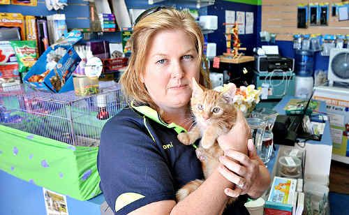 Pet Affair store owner Toni Turner is disheartened over the callous theft of her purse and mobile phone from behind the shop counter.
