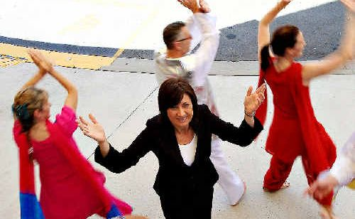 MP Justine Elliott is the centre of attention for the Tweed Respite staff Bollywood dancers.