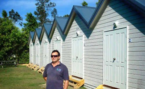 Richard Rawding, of the Solitary Islands Marine Park Resort, shows off the park's new cabins.