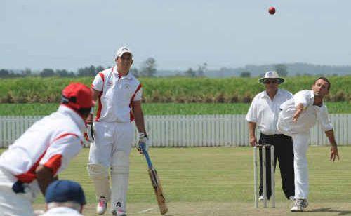 Harwood's Matt Young flights a delivery to South batsman Manesh Verma at Harwood on Saturday.