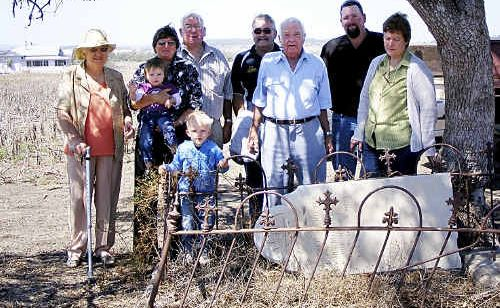 Visiting Dugald McIntyre's original gravesite are (from left) Lyla McIntyre, Carol McIntyre, Geoff McIntyre, Neil McIntyre, Laurie McIntyre (closest living relative), Chris McIntyre and Jan Taylor (nee McIntyre) and children Lachlan (left) and William.