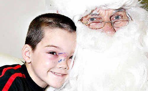 Santa brings smiles to Nambour General Hospital children's ward patients Jacob Lester, of Palmwoods, and inset, Conner McLaren, of Mooloolaba.
