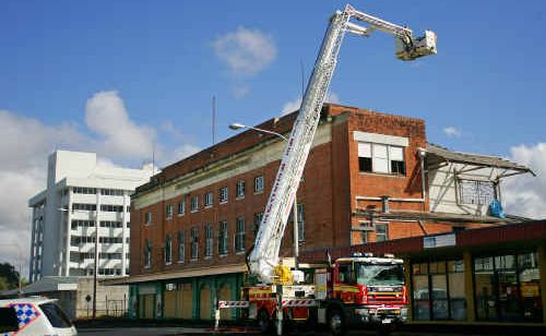 Firefighters control a blaze at the abandoned Wintergarden Theatre yesterday.
