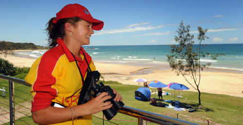 Minnie Water-Wooli surf club volunteer Pauline McLeod inspects the beach from the new surf club.