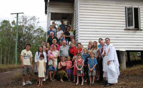 Father Paul Kelly and his congregation gather at the little church on Aramara's hill to celebrate the birth of Jesus.