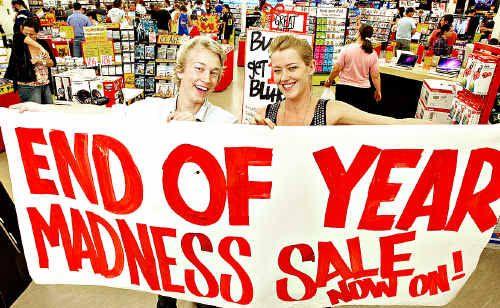 Staff at JB Hi Fi Ltd at Kawana Shoppingworld get ready for the Boxing Day sales.
