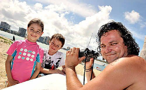 Holidaymaker Tom Medley, with Kaled and Kiara Severn, watched strange happenings on the Maroochy River.
