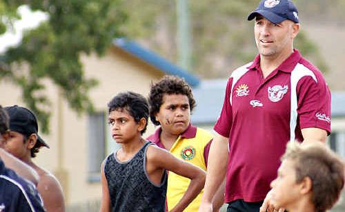 Sea Eagles mentor Brandon Costin passes on some tips at a coaching clinic in Cherbourg.