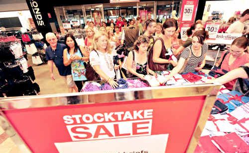 Hundreds crowded the door at Myer in Sunshine Plaza and rushed into the store in search of Boxing Day sales bargains.