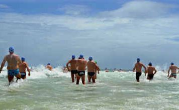 Starters in the men's section of the 2km ocean swim at Convent Beach yesterday take to the water.