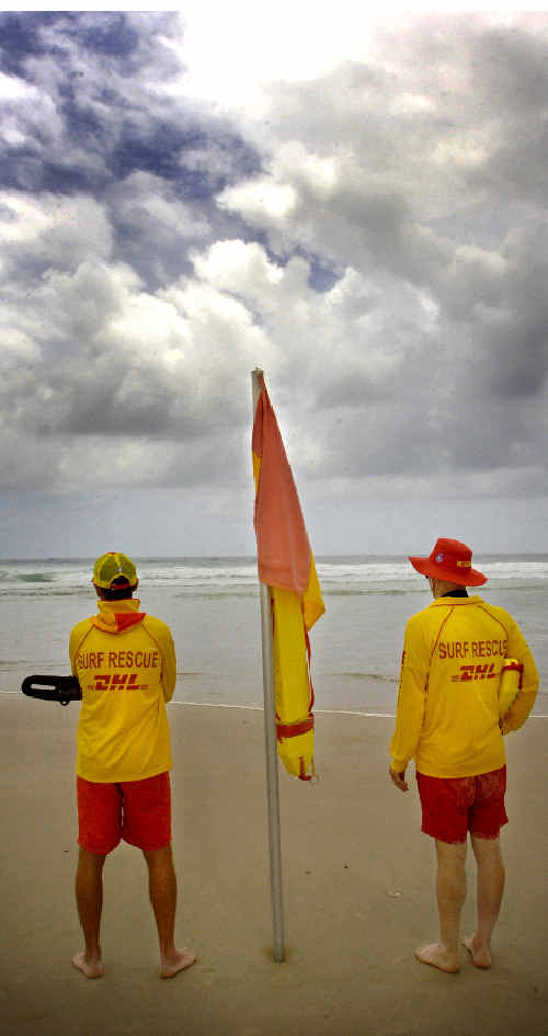 Lifesavers at Lighthouse Beach keep watch on the dangerous surf conditions causing strong southerly rips.
