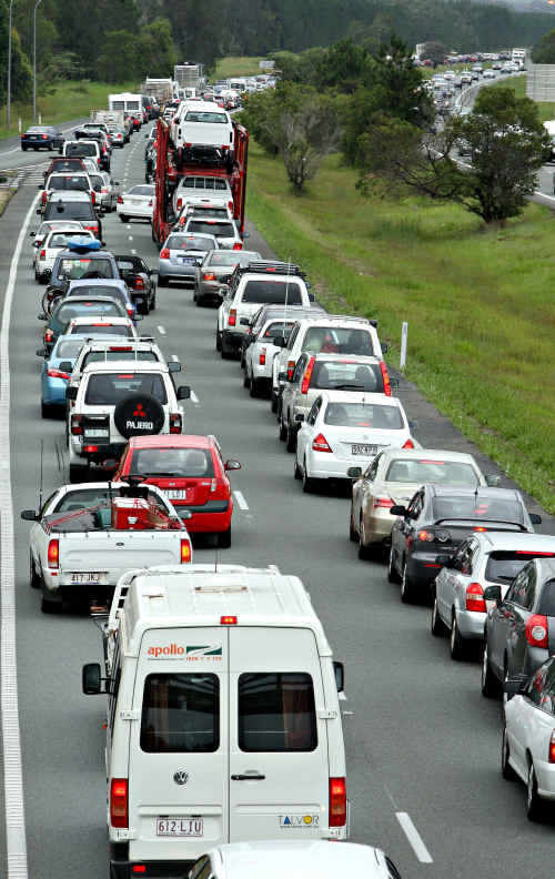 Traffic banks up in the northbound lane on the Bruce Highway near Moby Vic service station.
