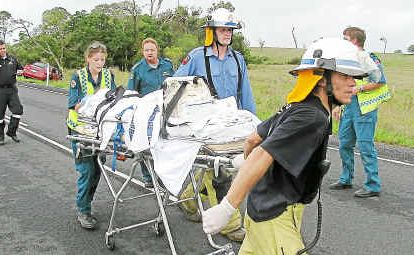 A patient is prepared to be airlifted after the fatal accident on Round Hill Road.