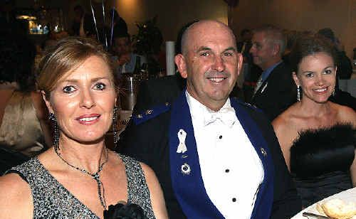 SUPERINTENDENT Michael Kenny and his wife Ellen (left), pictured a month ago at the Tweed Police Ball with Amanda Hall.