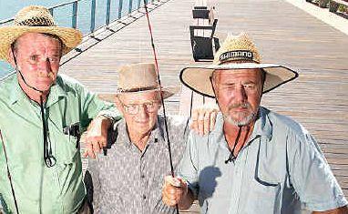 John Bolten, Trevor David and Gary Smythe want some shade on the promenade.