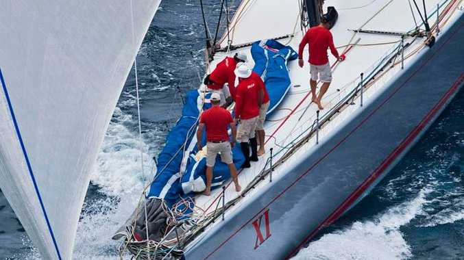 Wild Oats XI, skippered by Mark Richards, chasing down Alfa Romeo's lead.