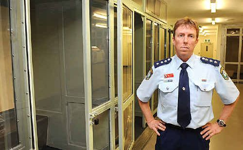 Inspector Greg Moore inspects the cells at the Lismore police station. He says they have lots of rooms available for anyone causing trouble tonight.