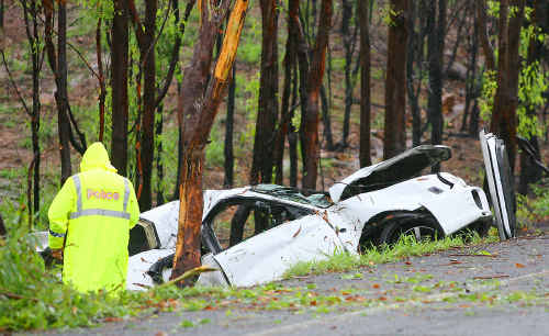Police investigate a fatal car crash on Rockhampton-Yeppoon Road yesterday morning.