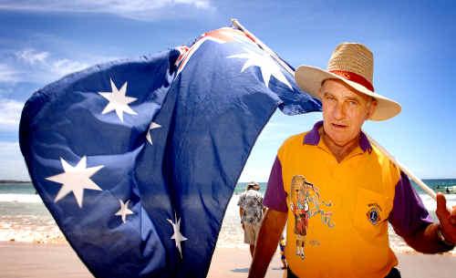 Maclean Lions' Ken Crampton holds his Australian-start flag.