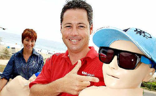 Bilinga Surf Life Saving Club member Lynne Bray and Westpac Bilinga executive manager Paul Lunney with two of the new training mannequins.