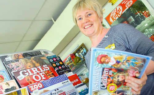 Lyndal Della-Bosca from Archer Park News chooses a calendar from the selection at her newsagency.