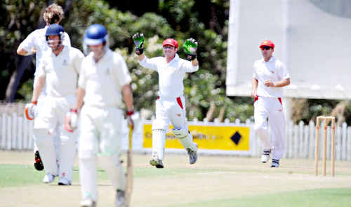 Scorchers captain and wicketkeeper Gerard Flegler celebrates a wicket.