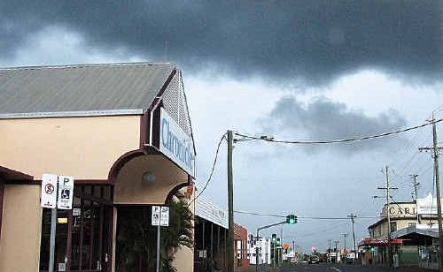 Thunderstorm clouds roll in Maryborough's CBD yesterday.