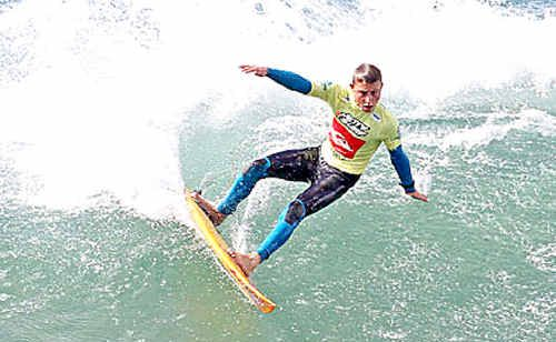 Harrison Mann, 15, takes to the water on day one of the Quiksilver Jetty Pro Junior at Jan Juc Beach, Victoria.