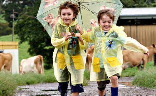 Lachlan and Nicholas Hollyoak in the Maleny rain.