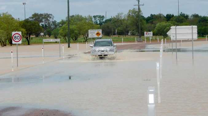 Flood waters cover the Sandy Creek culvert upgrade on the Longreach-Muttaburra Road at Longreach, west of Rockhampton.