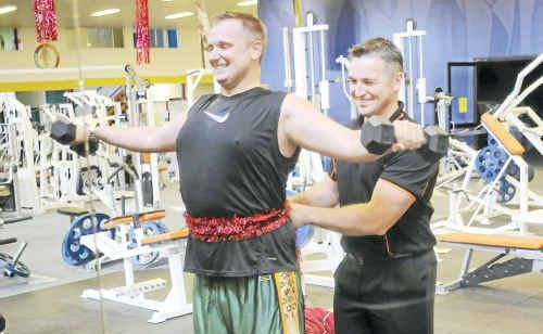 City Fit assistant manager David Cooke is encouraged to see patrons like Justin Bryer joining the gym to help shed a few of those unwanted Christmas kilos.