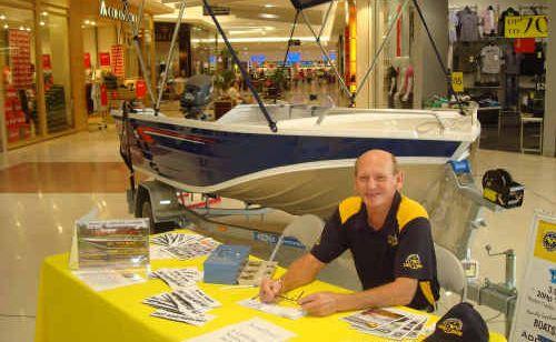 Bruce Bodsworth, of the Iluka-Yamba Coast Guard, selling raffle tickets in Grafton.