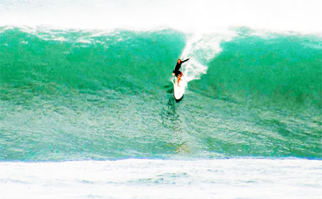 Surfing this monster wave is Queensland surfer Shakira Westdorp.