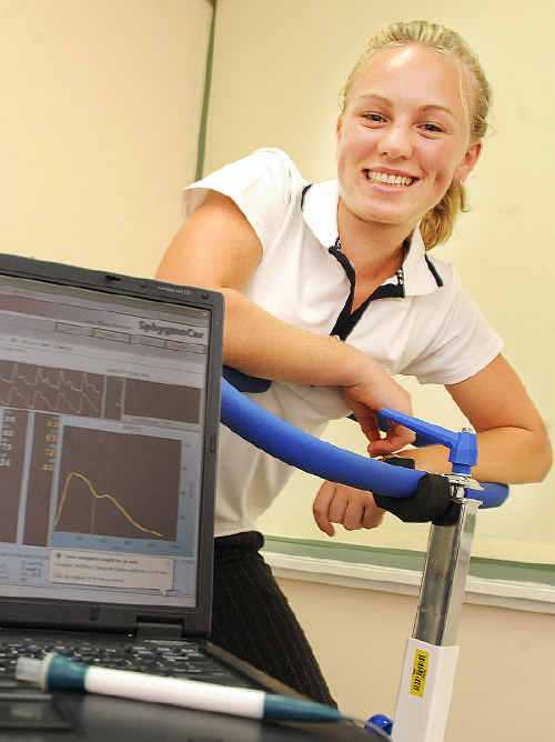Amy Coy, a third-year Southern Cross University Sport and Exercise Science student, checks blood pressure information recordings on a SphygmoCor.