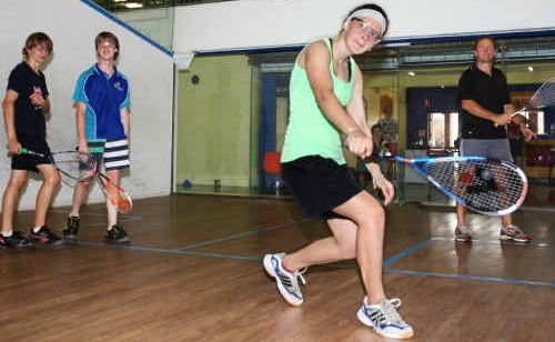 Beavan Mather, Alexander Craig and Amber Mather learn some of the finer points of squash.
