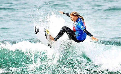 Buderim's Dimity Stoyle gives her all yesterday at the Quiksilver Jetty Surf Pro Junior in Victoria.