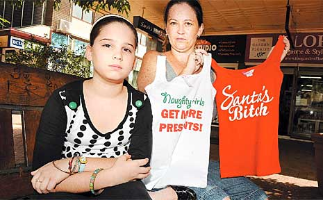 Michelle Bond and her daughter Mary, 10, with two of the Supre shirts bearing the risque messages.