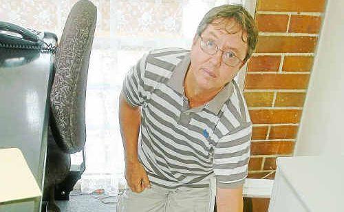 Coastline Realty Burnett Heads manager Len Harper surveys the damage to his business after a break and enter.