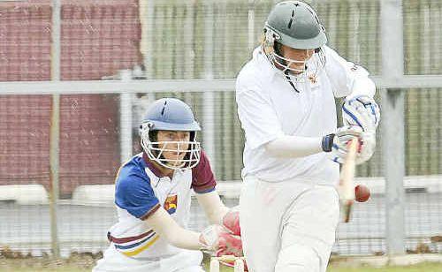 Northern Territory batsman Ben Ellis plays the ball to ground against Brisbane North during his unbeaten 88.