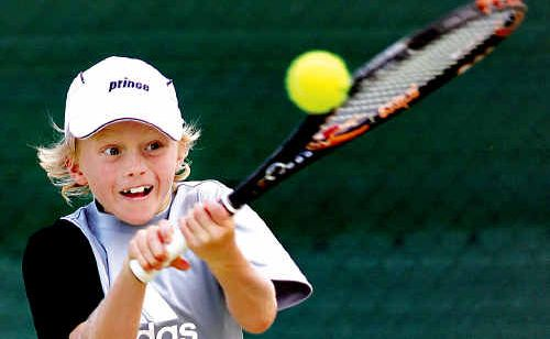 Kawana Island's Dane Sweeney, 8, has been relishing the opportunity to rub shoulders with some of the best tennis players in the world at the Brisbane International tournament this week.