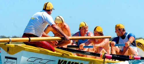 One of the Yamba surf boat crews competing at Main Beach, Yamba, last year.