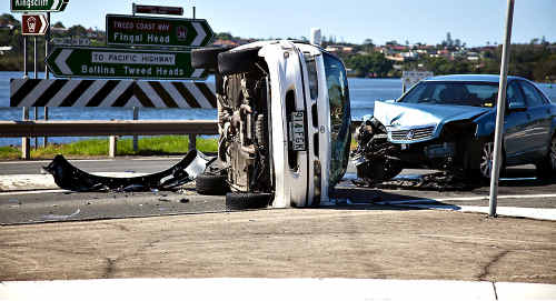 A man and his young family were fine after their car rolled on its side following a car crash in Chinderah yesterday.