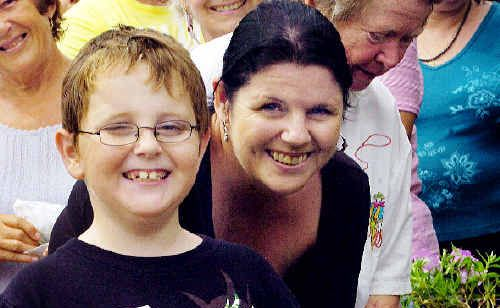 Jacob and his mum Sarah Dawe enjoy gardening but eating the rewards of your work is the best.
