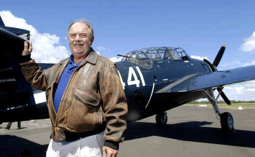 BEAUDESERT aviation collector Steve Searle with one of his favourite aircraft, the WWII Avenger, a torpedo bomber built by Grumman.