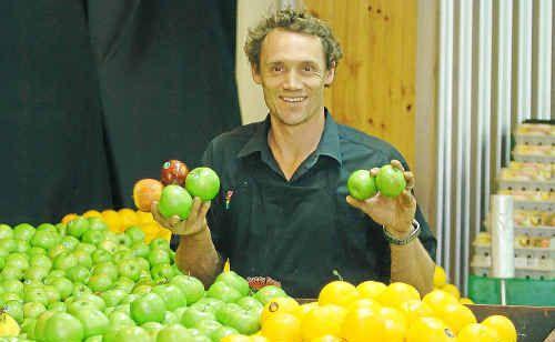 Bundy Fresh Food Market owner Glenn Pennington sells marked fruit cheaper.
