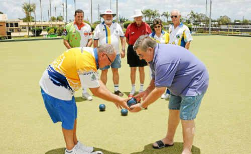 Noel Collin gets some coaching pointers from George Franklin (front) as Ashley Harris, Rex Clements, Dave Willsher, Carol Petersen and Koos Uildriks take note at the club coaching course held at Burnett Bowls Club on Saturday.